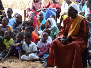 Demba Diawara with girls in his community of Keur Simbara, who will now not go through FGC